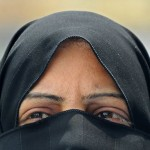 Muslim Woman With Pyramid Shaped Opening In Facial Covering