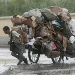 The Daily Insight - 7-23-09 - The Body Of A Man Pulling An Overloaded Cart Is Strongly Developed According To Yin Yang Principles